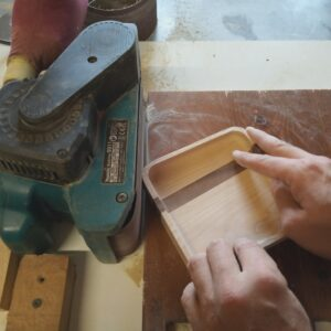 rounding the outer corners of the wooden trays