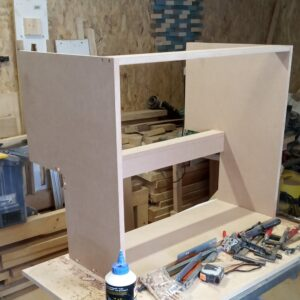 the small bathroom cabinet after we assembled all the MDF boards
