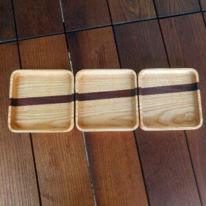this is our set of three DIY ash wood trays after we applied two coats of oil