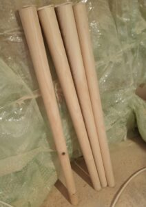 the four turned conical table legs,, before cutting them on angle