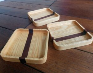 the three ash wood trays after two coats of oil applied