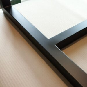 a small detail of the desk metal frame after the black paint has dried