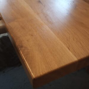 a small detail of the corner of the oak wood desk top