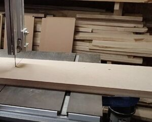 we clamped the scrap board on the band saw table in order to keep still during the cutting process