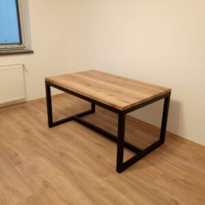 our home office desk with metal frame and oak table top has an industrial but modern look