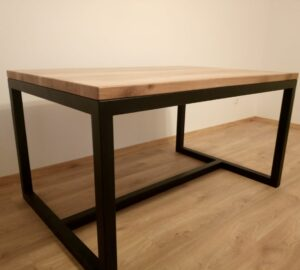 the black metal frame matches the oak wood desk top