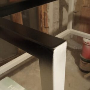 after the polyurethane primer has dried we started to apply the black matte polyurethane paint
