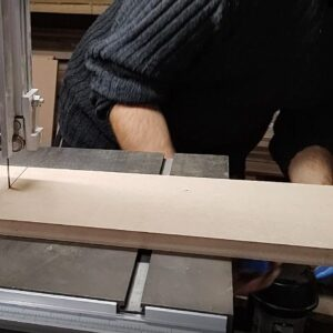 for the other end of bandsaw table we used a block of wood held on its place with a clamp