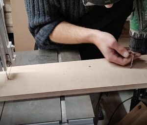 we drilled pilot holes into the board used for the bandsaw circle cutting jig