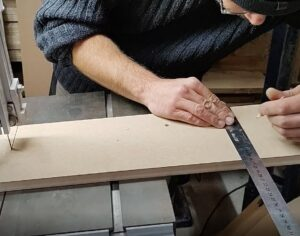 we established the places for the pilot holes on the board of our bandsaw circle cutting jig