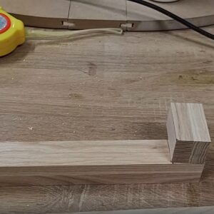I marked the ends of one piece of laminated ash plank to build the frames for the cabinet