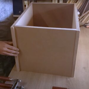 we started the building of the white floating nightstands by gluing two simple MDF boxes