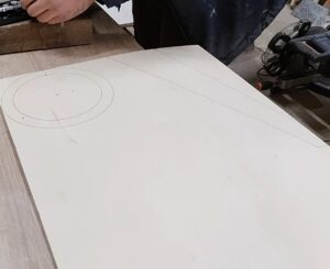 we drew on a piece of plywood the shape for the cylindrical frame and for the four legs