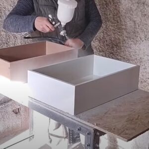 we painted the MDF drawers with white water based painted