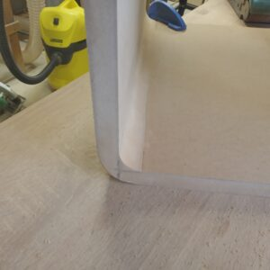 by using a mini belt sander we rounded the inner corners of the mid century floating nightstands\