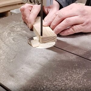 I used the bandsaw to cut the ends of the boards needed to build the adjustable work led light