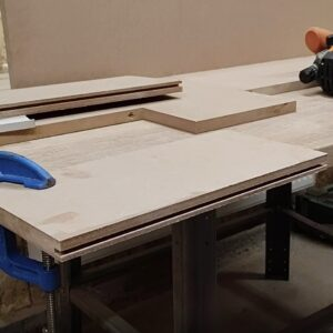 I turned back the MDF board and I secured it to the worktable so I could route the other half of the channel