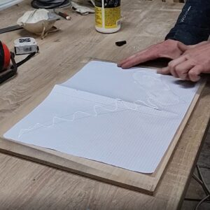 I applied the adhesive to glue up the check box on a piece of plywood in order to build the template for my wooden floating bookshelves