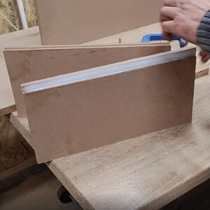 I inserted the 8 mm thick MDF strip in the routed channel and I beat it with a rubber mallet