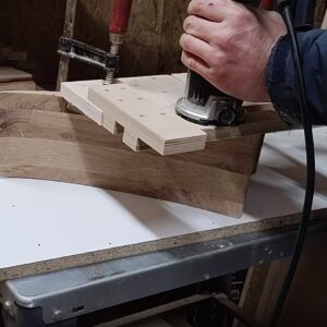I used a plywood jig to route the slots for secure the wooden square frames into the back of the simple wooden wall mounted bookshelves