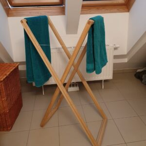 the folding towel rack made out of laminated ash wood boards