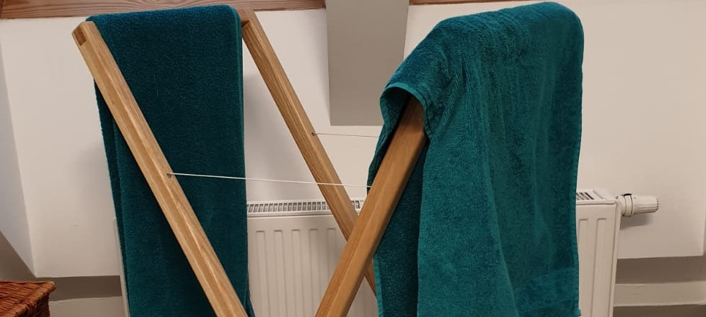 the folding towel rack was build out of laminated ash wood planks