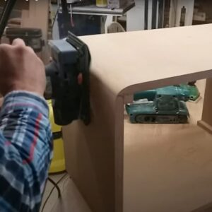 we made circular movements with the sheet orbital sander to round the corners of the nightstand boxes
