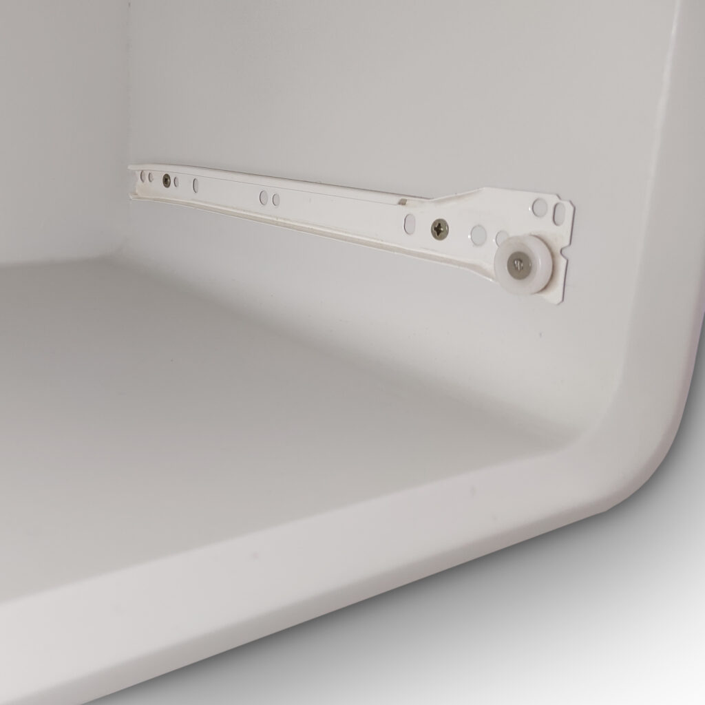 a white piece of MDF furniture with rounded inner corners