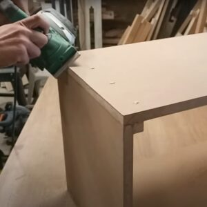 we beveled the sharp corner of the nightstand box with an electric planer