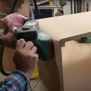 we used the belt sander to round the outer corners of he nightstand boxes