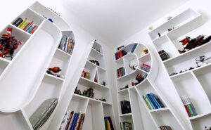 the letters bookshelves were mounted on the corner