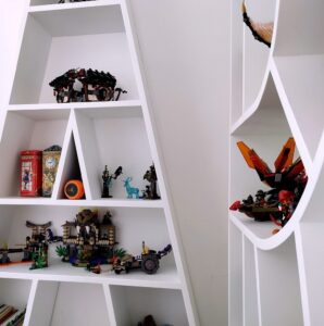 we chose a modern design of letters bookshelves for our kids' room